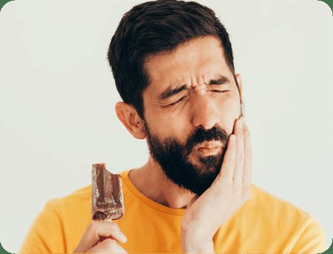 Man with Teeth sensitivity holding icecream in one hand